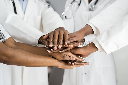african american medical team haende stack