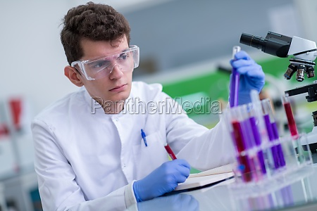 student, with, protective, glasses, making, chemistry - 30065037