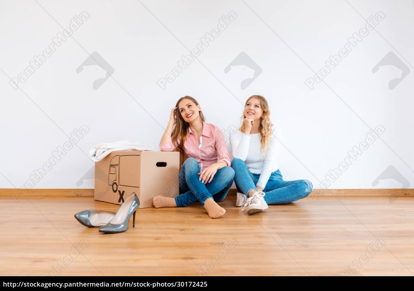 two, women, in, new, apartment, dreaming - 30172425