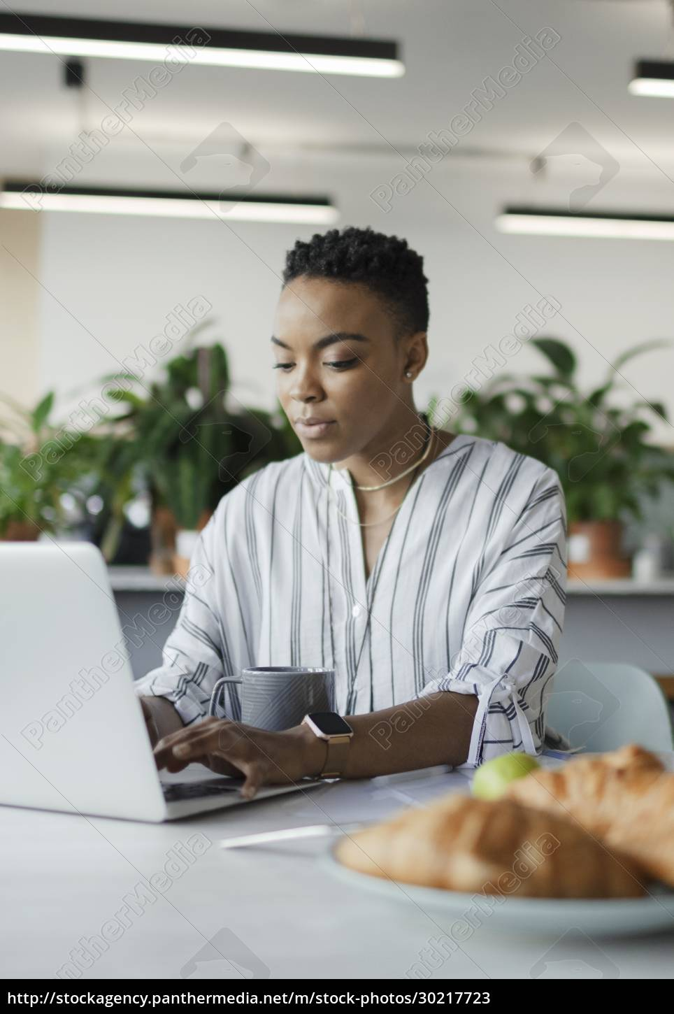 businesswoman, working, at, laptop, in, morning - 30217723