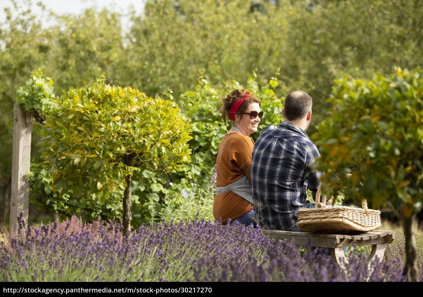 couple, taking, a, break, from, gardening - 30217270