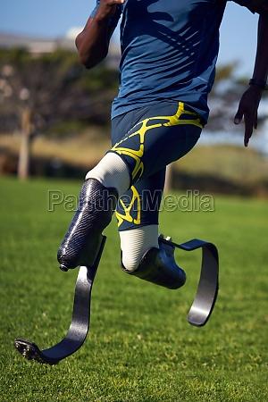 male, amputee, athlete, sprinting, on, sunny - 30218920