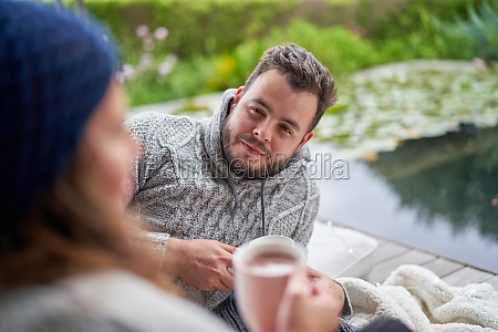 man, listening, to, wife, on, patio - 30222169