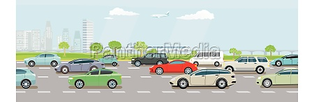 schnellstrasse mit starkem autoverkehr und schnellzug