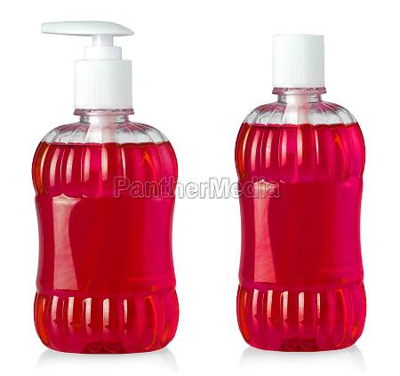 rote duschgelflaschen isoliert auf weissem hintergrund